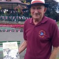 Barry displays a copy of 'The Athletic Grounds of Loughborough' at a history event in Queen's Park, Loughborough.