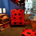 One of the ladybirds from the Beeches Road factory sits above the new talking story chair.