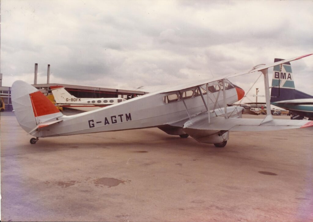 De Havilland D.H.89 Dragon Rapide G-AGTM (built as a military Dominie. NF875, in May 1944.) Seen here at East Midlands Airport on 4th September 1978 prior to a display over the Brush Electrical Machines Gala Day at the Nanpantan Road Sports Ground organised by the Brush Transport Enthusiast's Club. (Brush Electrical Machines/Brush Transport Enthusiast's Club – Tony Jarram Collection)